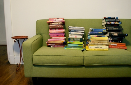 Corona sofa, green sofa, Ravenswood, Linoln Square apartment, stacked books