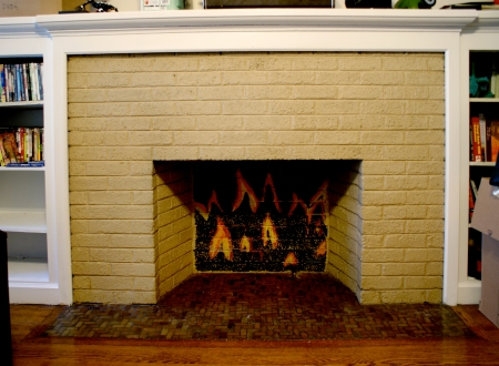 painted brick, faux fireplace, mantel, painted flames, Ravenswood apartment, Lincoln Square apartment
